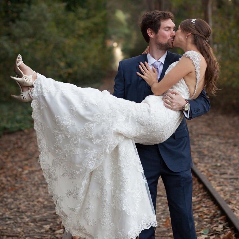 bride and groom on railroad tracks