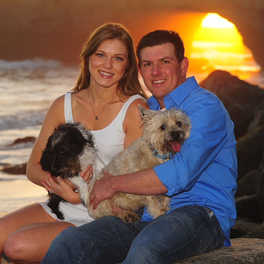 engaged couple with dogs
