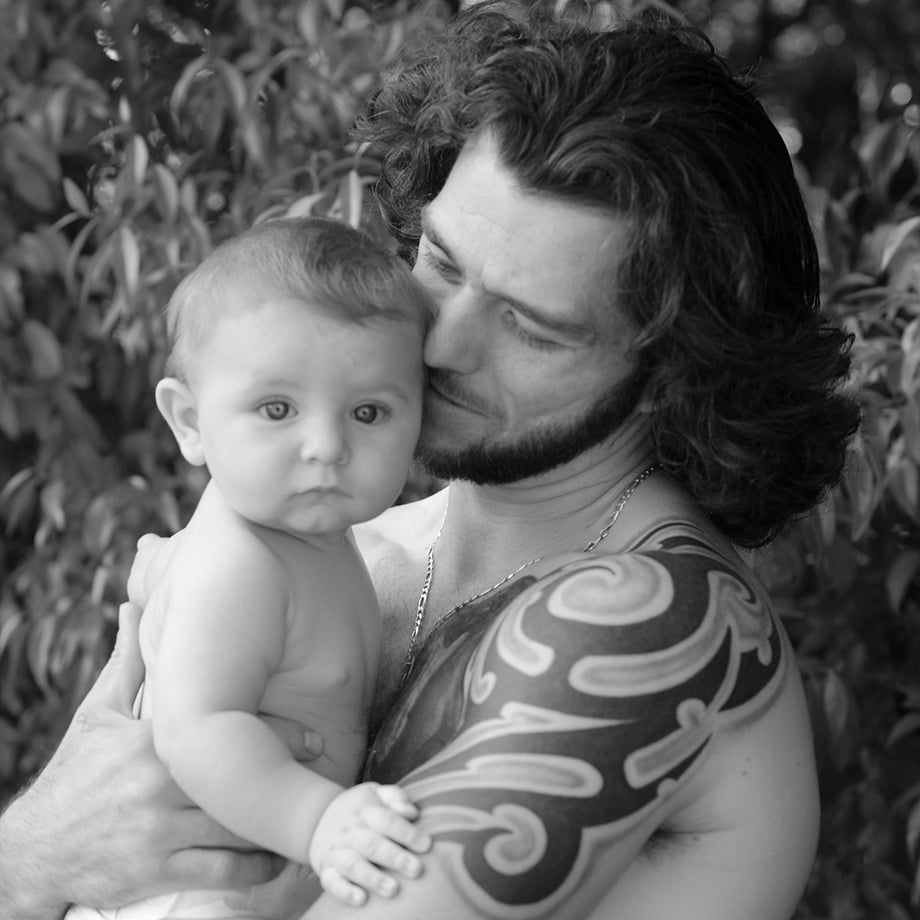 baby and tattoo dad
