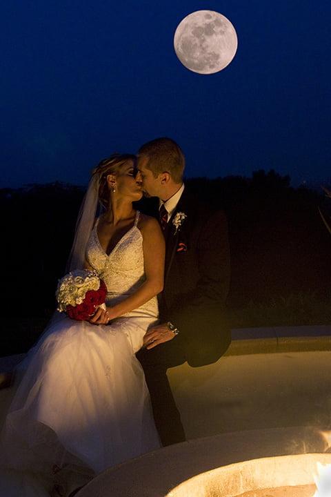 full moon wedding kiss