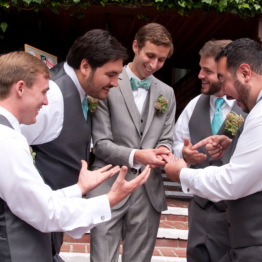 groom's crew checking out wedding ring