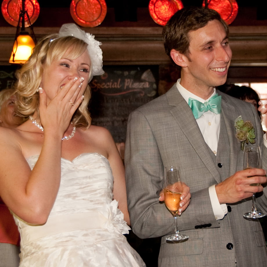 chuckling bride and groom