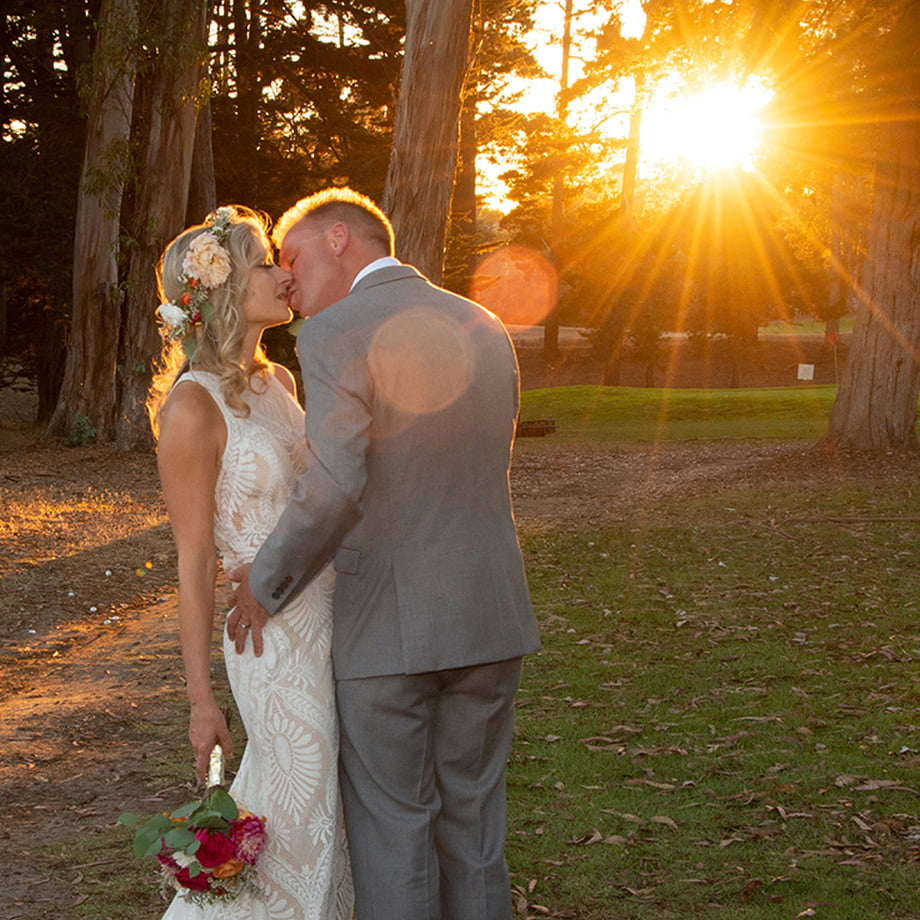sunset in the woods newly weds kissing