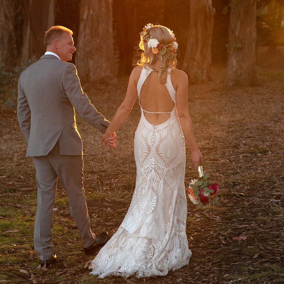 newly married couple walking in the woods