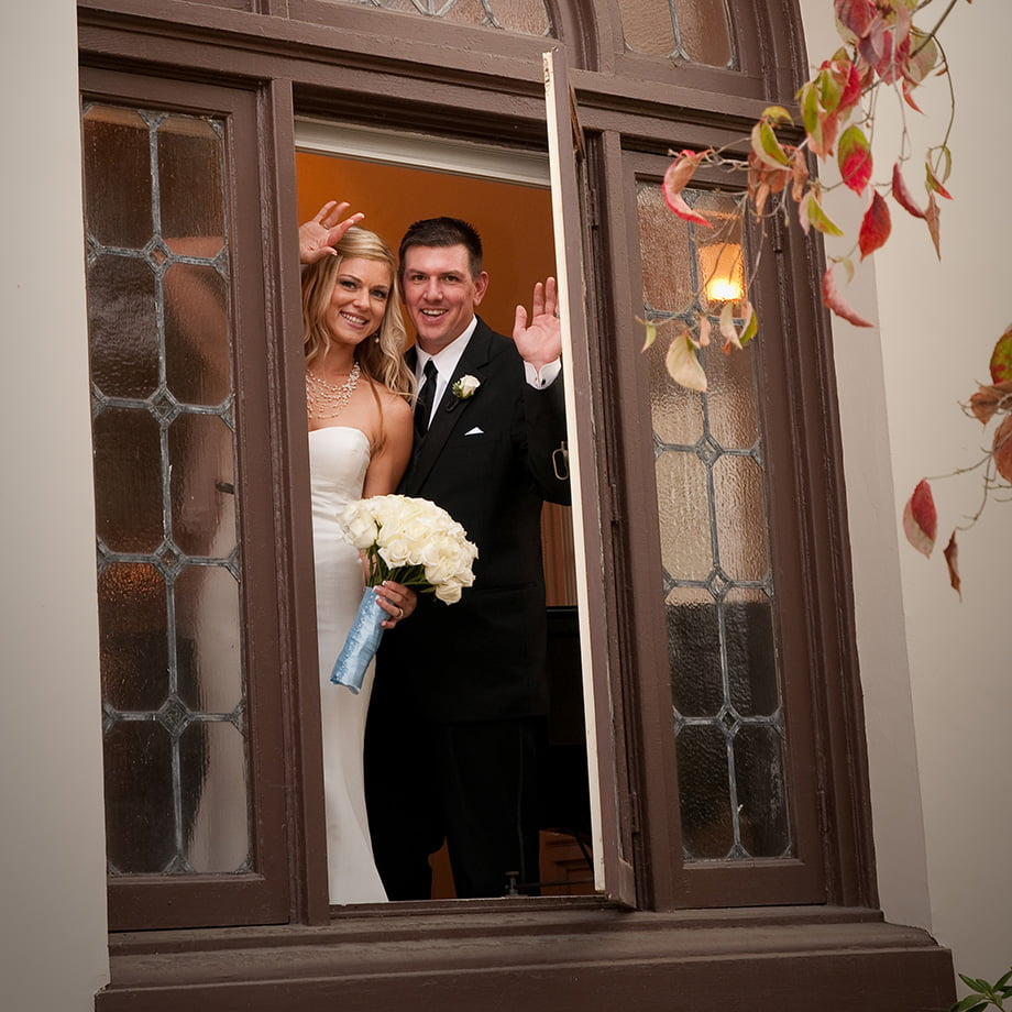 Just married and standing at the window