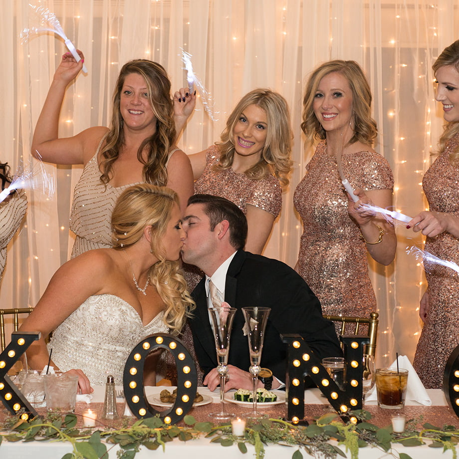Bride, groom and bridesmaids party it up at the wedding